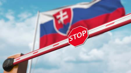 enable : Opening boom barrier with stop sign against the Slovak flag. Free border crossing or lifting a ban in Slovakia Stock Footage