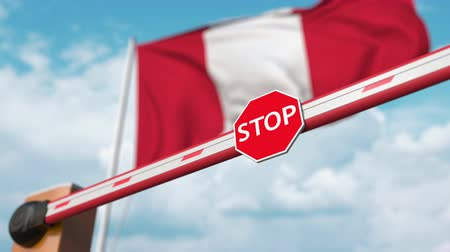 abriu : Opening boom barrier with stop sign against the Peruvian flag. Free entry or lifting a ban in Peru Stock Footage