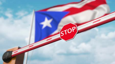 enable : Opening boom barrier with stop sign against the Puerto rican flag. Free entry or lifting a ban in Puerto rico