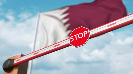 přijmout : Barrier gate being opened with flag of Qatar as a background. Qatari Free entry or lifting a ban
