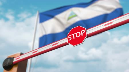 nicaraguan : Barrier gate being opened with flag of Nicaragua as a background. Nicaraguan Free border crossing or lifting a ban