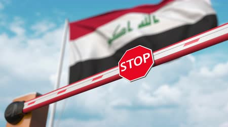 přijmout : Barrier gate being opened with flag of Iraq as a background. Iraqi Free entry or lifting a ban