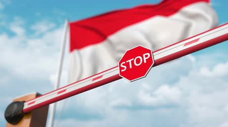 allow : Open boom gate on the Indonesian flag background. Free entry or lifting a ban in Indonesia Stock Footage