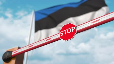 authorise : Opening boom barrier with stop sign against the Estonian flag. Free entry or lifting a ban in Estonia