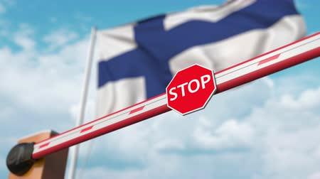 přijmout : Opening boom barrier with stop sign against the Finnish flag. Free entry or lifting a ban in Finland