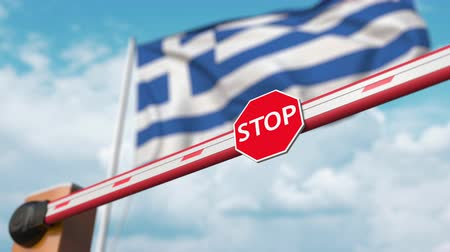 immigratie : Open boom gate on the Greek flag background. Free entry or lifting a ban in Greece
