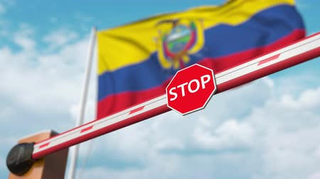 authorise : Barrier gate being opened with flag of Ecuador as a background. Ecuadorian Free entry or lifting a ban Stock Footage