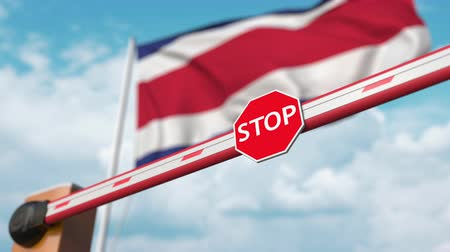 accepting : Barrier gate being opened with flag of Costa rica as a background. Costa rican Free entry or lifting a ban
