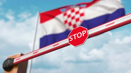 convidar : Opening boom barrier with stop sign against the Croatian flag. Free entry or lifting a ban in Croatia