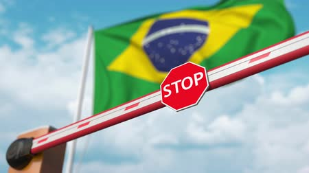 brezilya : Open boom gate on the Brazilian flag background. Free entry or lifting a ban in Brazil