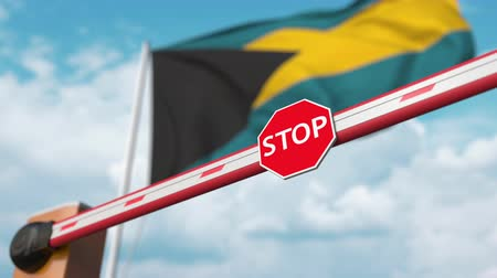 abriu : Open boom gate on the Bahamian flag background. Free entry or lifting a ban in Bahamas