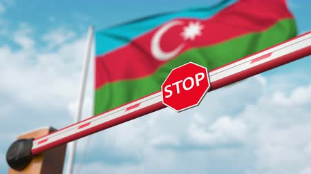 passero : Opening boom barrier with stop sign against the Azerbaijani flag. Free entry or lifting a ban in Azerbaijan
