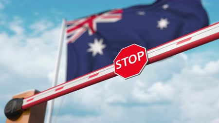 accepting : Open boom gate on the Australian flag background. Free entry or lifting a ban in Australia