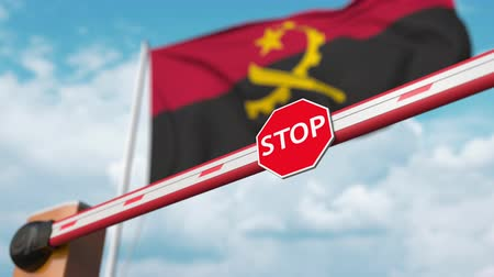 entrer : Open boom gate on the Angolan flag background. Free entry or lifting a ban in Angola Vidéos Libres De Droits