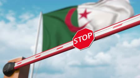 algeria : Barrier gate being opened with flag of Algeria as a background. Algerian Free entry or lifting a ban