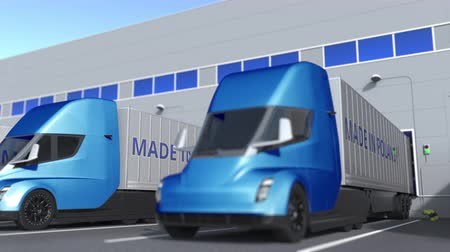 unload : Modern semi-trailer trucks with MADE IN POLAND text being loaded or unloaded at warehouse. Polish business related loopable 3D animation