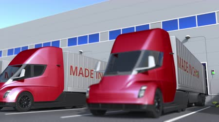 transporte de carga : Modern semi-trailer trucks with MADE IN CHINA text being loaded or unloaded at warehouse. Chinese business related loopable 3D animation