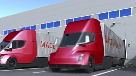 izrael : Modern semi-trailer trucks with MADE IN ISRAEL text being loaded or unloaded at warehouse. Israeli business related loopable 3D animation