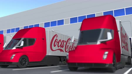 kola : Trailer trucks with Coca-Cola logo being loaded or unloaded at warehouse. Logistics related loopable 3D animation Stok Video