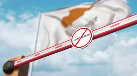 entrer : Opening boom barrier with stop immigration sign against the Cypriot flag, immigration approval in Cyprus