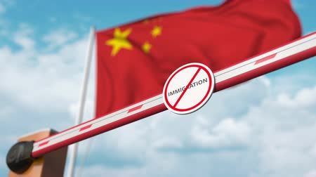 siyasi : Opening boom barrier with stop immigration sign against the Chinese flag, immigration approval in China Stok Video