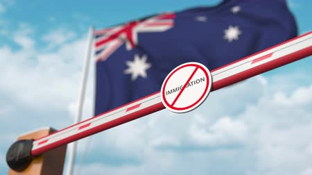 siyasi : Open boom gate with no immigration sign on the Australian flag background. Immigration approval in Australia