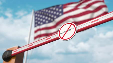 siyasi : Opening boom barrier with stop immigration sign against the American flag, immigration approval in the USA Stok Video