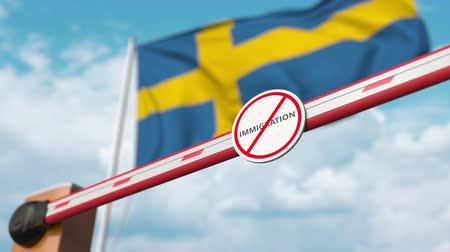 bariéra : Opening boom barrier with stop immigration sign against the Swedish flag, immigration welcome center in Sweden