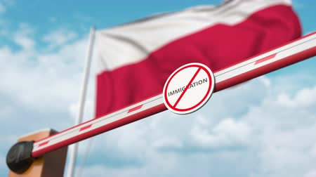 göçmen : Open boom gate with no immigration sign on the Polish flag background. Immigration approval in Poland