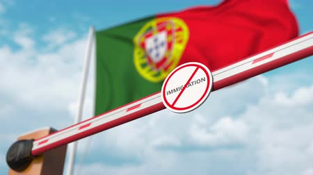girmek : Open boom gate with no immigration sign on the Portuguese flag background. Immigration approval in Portugal