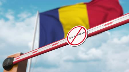 siyasi : Open boom gate with no immigration sign on the Romanian flag background. Immigration approval in Romania
