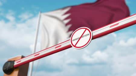 siyasi : Barrier gate with no immigration sign being opened with flag of Qatar as a background. Qatari immigration approval