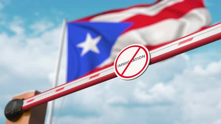 siyasi : Opening boom barrier with stop immigration sign against the Puerto Rican flag, immigration approval in Puerto Rico