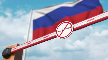 siyasi : Barrier gate with no immigration sign being opened with flag of Russia as a background. Russian immigration approval