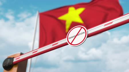 siyasi : Opening boom barrier with stop immigration sign against the Vietnamese flag, immigration approval in Vietnam