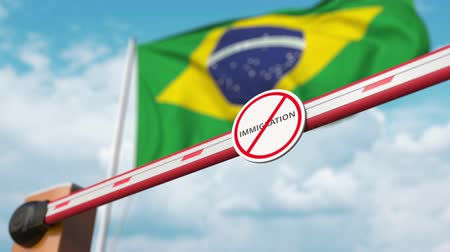brazilian : Open boom gate with no immigration sign on the Brazilian flag background. Immigration approval in Brazil