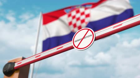 siyasi : Opening boom barrier with stop immigration sign against the Croatian flag, immigration approval in Croatia