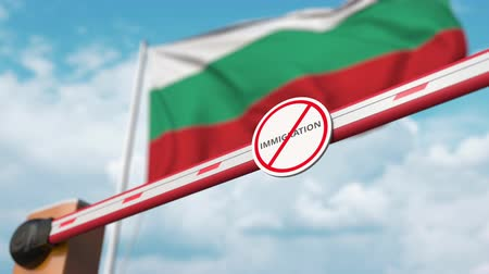 göçmen : Open boom gate with no immigration sign on the Bulgarian flag background. Immigration approval in Bulgaria