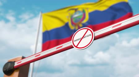 siyasi : Barrier gate with no immigration sign being opened with flag of Ecuador as a background. Ecuadorian immigration approval Stok Video