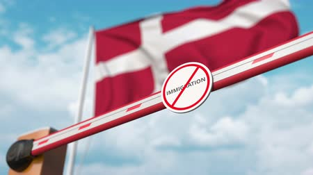 siyasi : Open boom gate with no immigration sign on the Danish flag background. Immigration approval in Denmark