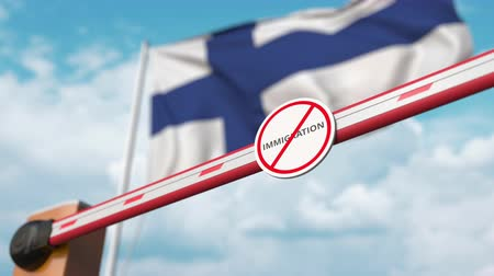 göçmen : Opening boom barrier with stop immigration sign against the Finnish flag, immigration approval in Finland Stok Video