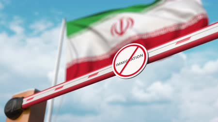 siyasi : Open boom gate with no immigration sign on the Iranian flag background. Immigration approval in Iran