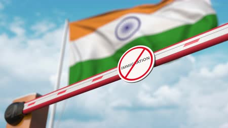 siyasi : Barrier gate with no immigration sign being opened with flag of India as a background. Indian immigration approval