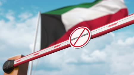 siyasi : Opening boom barrier with stop immigration sign against the Kuwaiti flag, immigration welcome center in Kuwait Stok Video