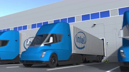 intel : Electric trailer trucks with Intel logo being loaded or unloaded at warehouse. Logistics related loopable 3D animation Stock Footage
