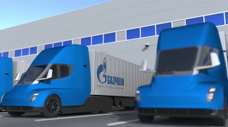 gazprom : Semi-trailer trucks with Gazprom logo being loaded or unloaded at warehouse. Logistics related loopable 3D animation