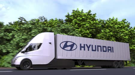 sobressalente : Electric semi-trailer truck with HYUNDAI logo on the side. Editorial loopable 3D animation Vídeos