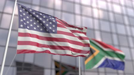 siyasi : Flying flags of the United States and South Africa in front of a modern skyscraper