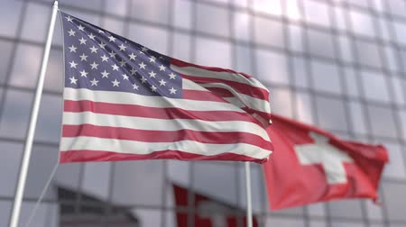 siyasi : Waving flags of the United States and Switzerland in front of a modern skyscraper Stok Video