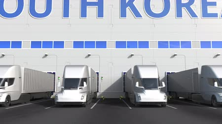 kapasite : Modern semi-trailer trucks at warehouse loading dock with PRODUCT OF SOUTH KOREA text. South Korean logistics related 3D animation Stok Video